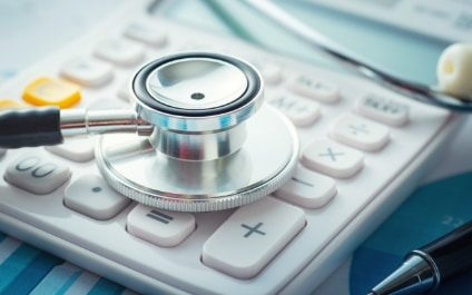 Image of a stethoscope and calculator