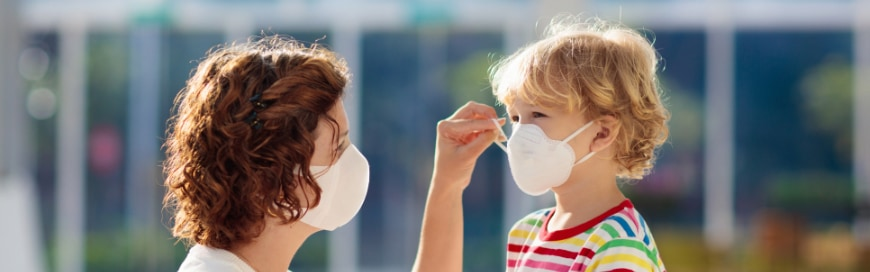 Photo of a mom and child wearing face masks